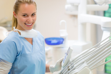 Female dentist with dental equipment at surgery