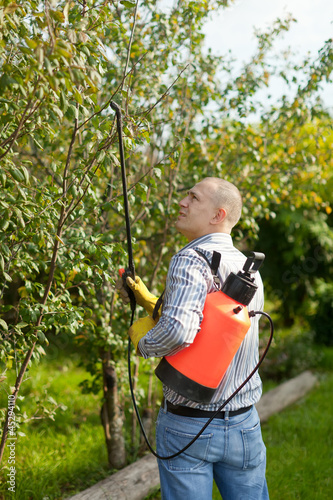 working man with garden spray