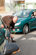 Man helping woman with her broken car