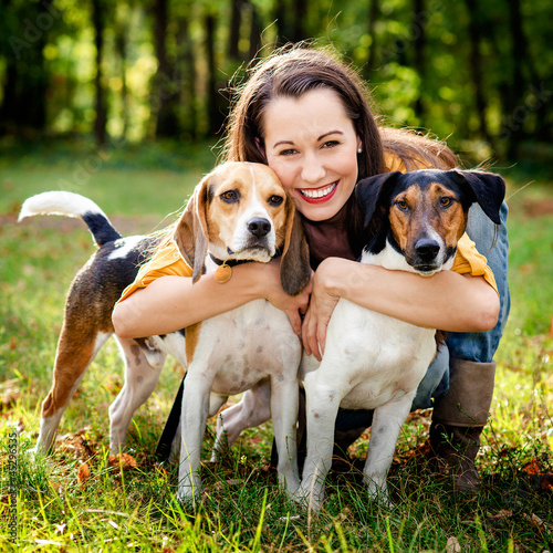 beautiful woman and his dogs posing outside
