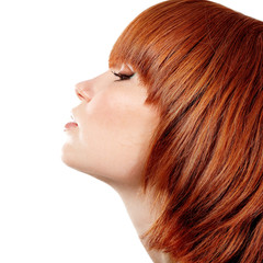 profile of young beautiful redheaded teen girl