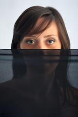 Woman portrait with black veil.