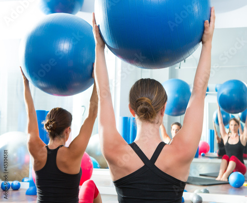 Fototapeta stability ball in women Pilates class rear view
