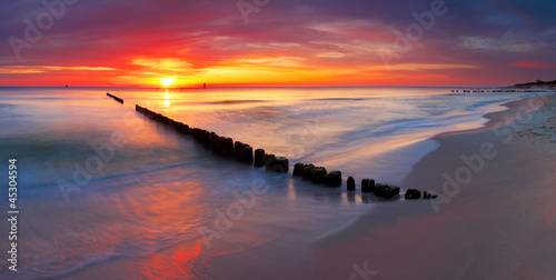 Baltic sea at beautiful sunrise in Poland beach. © TTstudio