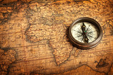 Fototapety Old vintage compass on ancient map