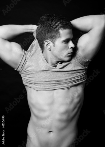 Man with a muscular body on black background