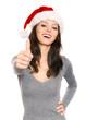 Weihnachtsfrau zeigt Daumen