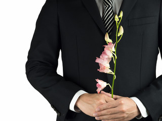 man with a small flower on white background