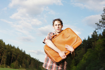 young man holding a suitcase