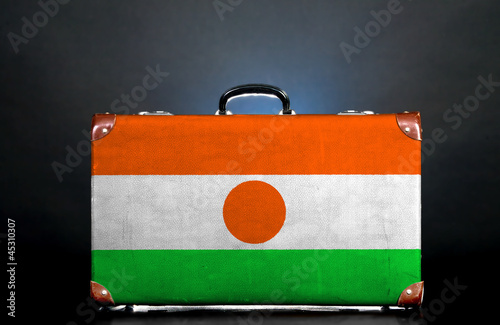 flag on a suitcase for travel.