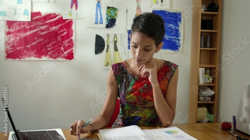 Small business, woman doing budget in fashion designer atelier