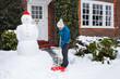 Leinwanddruck Bild - Person shoveling snow