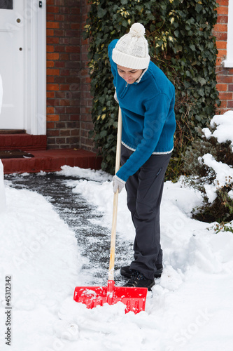 Woman with snow shovel