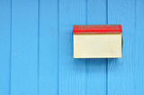 Grunge postbox on blue wood wall poster