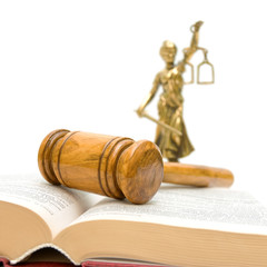 gavel, law book, a statue of justice on a white background