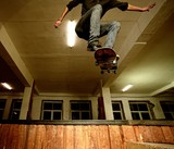Young man performing a stunt in a skatepark poster