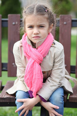 portrait of a beautiful girl in a pink scarf