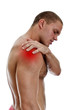 Young man suffering from pain in his shoulder. Isolated