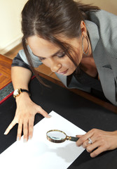 woman looks on document