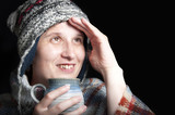 Woman get warming up with a cup of hot tea