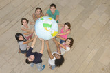 Group  holding  the Earth Globe showing America
