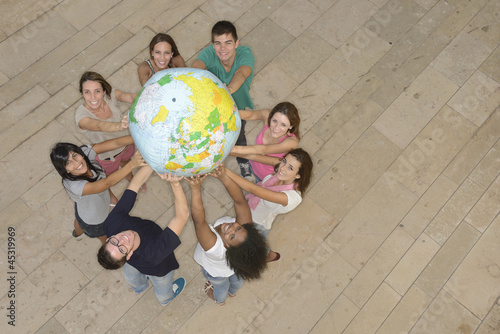 Group holding  the Earth Globe showing Europe
