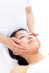 attractive asian woman on facial massage
