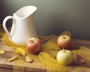 Autumn still life with leaves and apples
