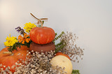 Fall decoration with pumpkins, marigolds and dry flowers