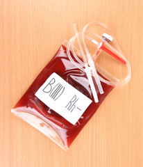 Bag of blood and infusion on wooden background
