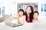 Happy family enjoying entertainment on laptop
