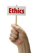 Hand Held Ethics Sign In Fist On White
