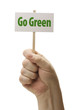 Hand Held Go Green Sign In Fist On White
