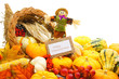 Happy Thanksgiving card among a cornucopia of vegetables