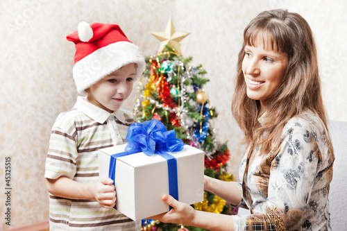 Mother and son with new year present or christmas holiday gift b