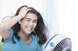 Beautiful young woman or teen enjoying cool fan breeze