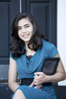 Beautiful, well dressed, young woman holding computer tablet