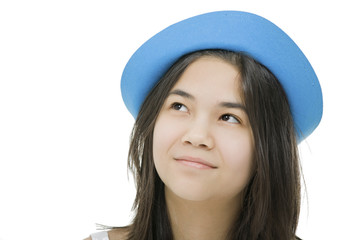 Young teenage girl in blue hat, with thoughtful expression.Isola