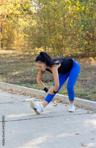 Fit woman limbering up