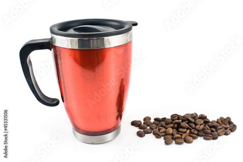 Red thermos with coffee beans