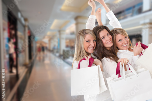 Three happy shoppers