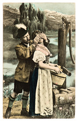 funny flirting couple in typical bavarian dress