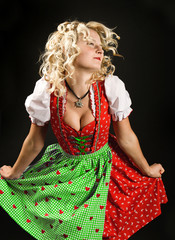 dancing girl in typical bavarian dress dirndl