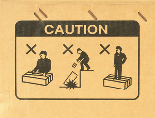 Caution symbol on cardboard
