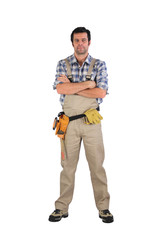 Serious laborer with arms crossed