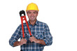 Tradesman holding a pair of large pliers