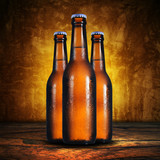 3 beer bottles on grunge background