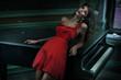Cute woman wearing red dress