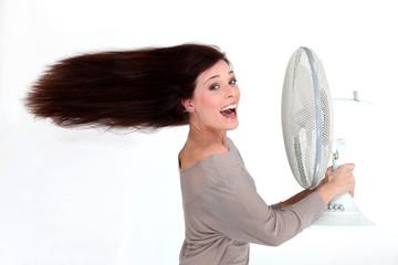 Brunette stood in front of fan