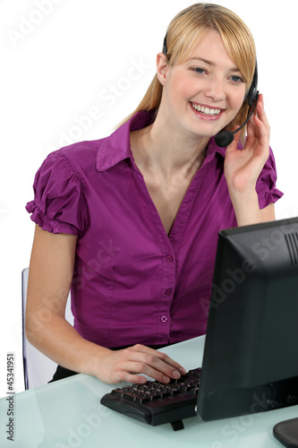 Woman with a headset laughing